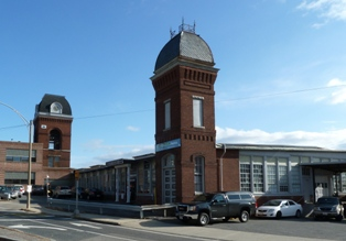 Image of the tower of an old 19th century red brick manufacturing building