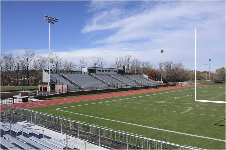image of a football field with grandstands