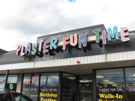Image of the Plaster Fun Time entry sign - colorful letters at angles so they're not all straight