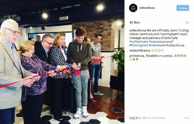 Sofa Cafe Grand Opening - image of seven officials cutting a red ribbon inside the new cafe