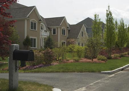 view of large single family homes in a suburban neighorhood- along Doeskin Dr in Nobscot