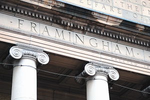 close up of Framingham Town Hall entry showing pediment and tops of columns and the word Framingham