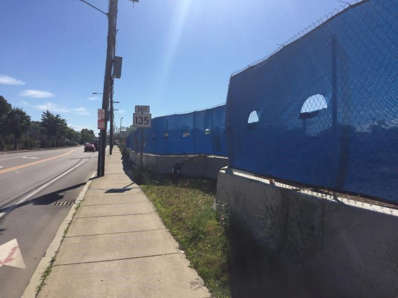 Image of the blue construction fence up at 266 Waverly Street - June 2018